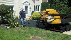 picture of Mr. Kane building a new asphalt driveway